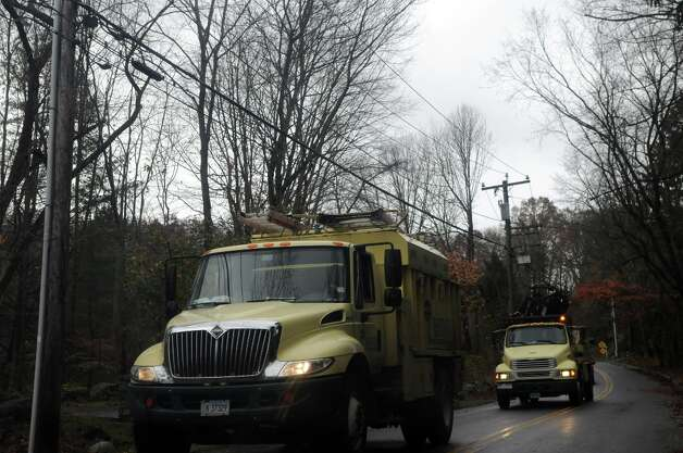 A Bartlett Tree crew passes along Hunting Ridge Road after Hurricane Sandy related weather in Stamford, Conn., Oct. 30, 2012. Photo: Keelin Daly / Stamford Advocate Freelance