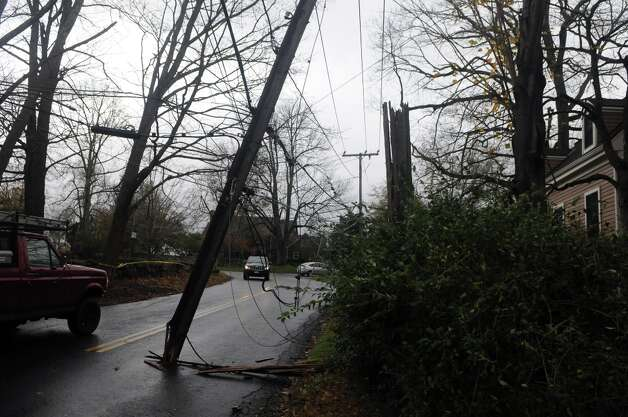 Drivers pass under hanging wires along Davenport Ridge Road after Hurricane Sandy related weather hit Stamford, Conn., Oct. 30, 2012. Photo: Keelin Daly / Stamford Advocate Freelance