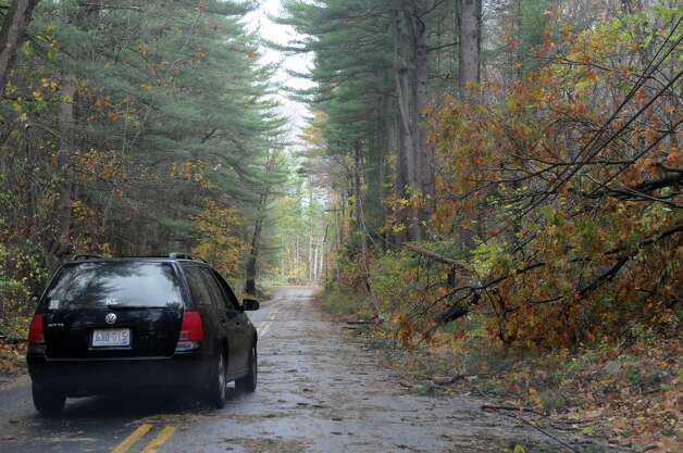 Power lines and tree limbs line Lakeside Drive after Hurricane Sandy related weather in Stamford, Conn., Oct. 30, 2012. Photo: Keelin Daly / Stamford Advocate Freelance