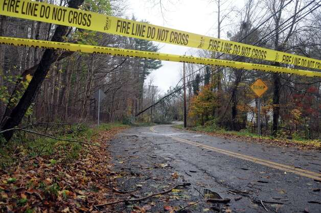 Power lines and tree limbs line North Stamford Road after Hurricane Sandy related weather in Stamford, Conn., Oct. 30, 2012. Photo: Keelin Daly / Stamford Advocate Freelance