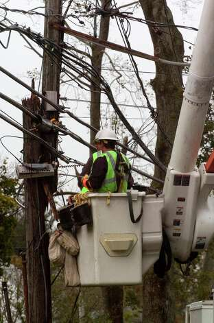 Utility workers from Kansas City work to repair damage along Shippan Avenue in Stamford, Conn., caused by the effects of Hurricane Sandy on Tuesday, Oct. 30, 2012. Photo: Jason Rearick / The News-Times