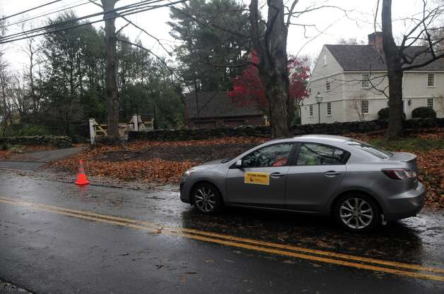 "A ""Power Patrol"" official from Connecticut Light and Power keeps an eye on downed power lines on Scofieldtown Road after Hurricane Sandy related weather in Stamford, Conn., Oct. 30, 2012. Photo: Keelin Daly / Stamford Advocate Freelance"