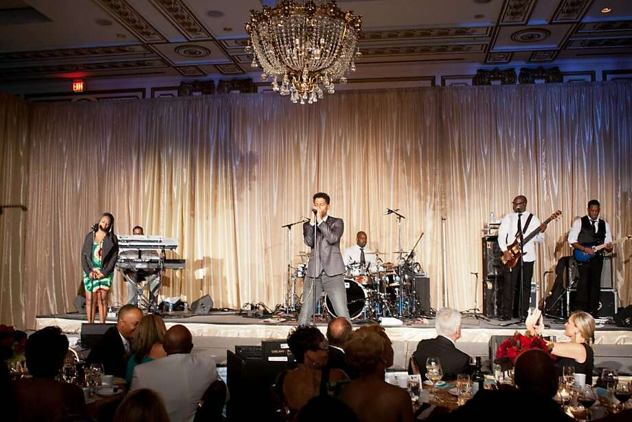 The Museum of the African Diaspora is known for bringing guests top-flight musical entertainment, and did not disappoint at the 7th annual fundraising gala at the Palace Hotel Oct. 26, 2012. Here, guests enjoy a performance by Eric Benet. Photo: Drew Altizer Photography, Drew Altizer