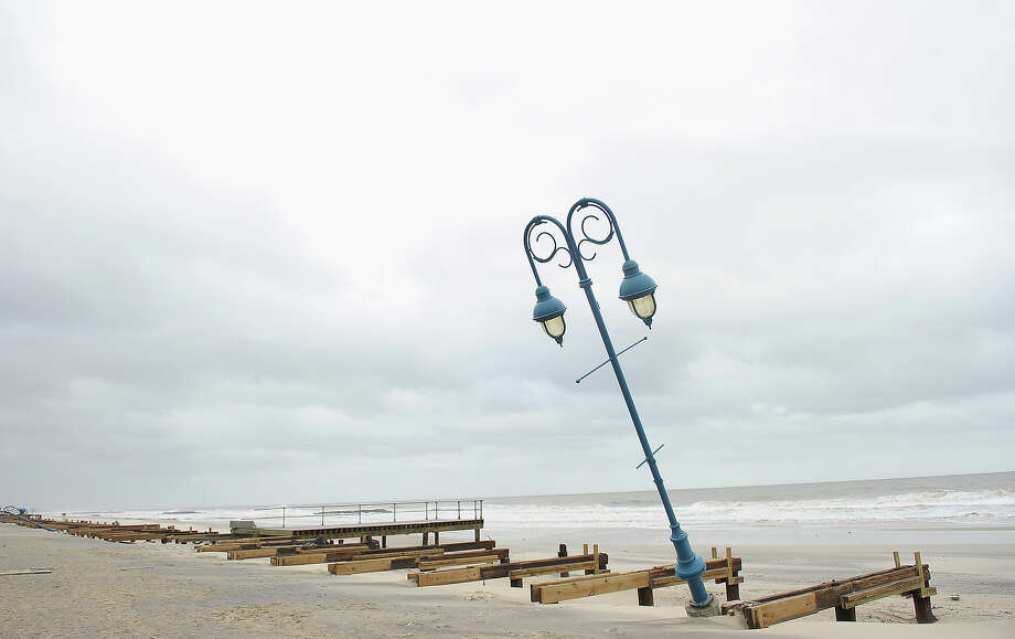 What remains of the boardwalk sits on the beach on October 30, 2012 in Belmar, New Jersey. Most of the 1.2-mile boardwalk in Belmar was completely wiped out, the north half of the boardwalk was blown and washed away, and the southern half was completed annihilated. Photo: Michael Loccisano, Getty Images / 2012 Getty Images