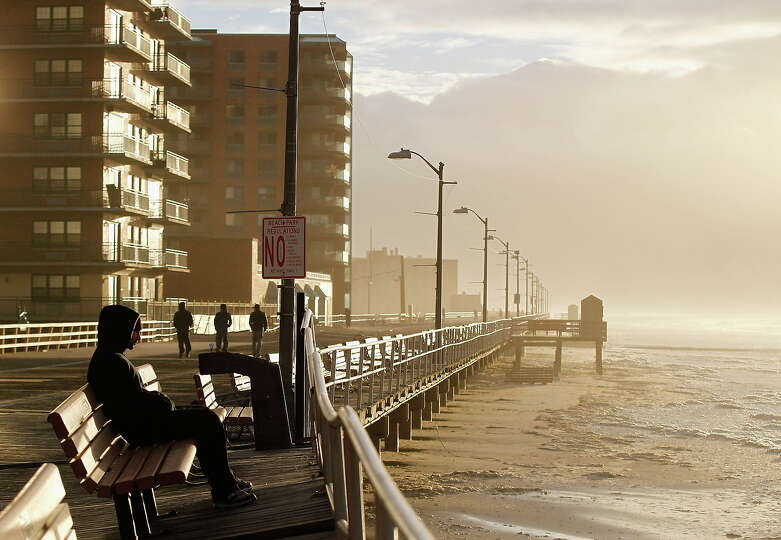 The heavy surf breaks against the boardwalk on October 30, 2012 in Long Beach, New York. The storm h