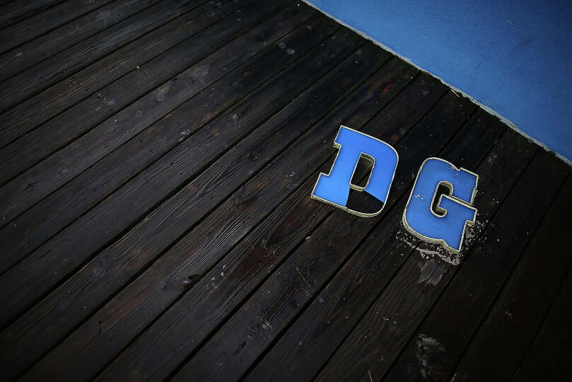 The letters D and G lie on the boardwalk after falling from a fudge shop sign, on October 30, 2012 i