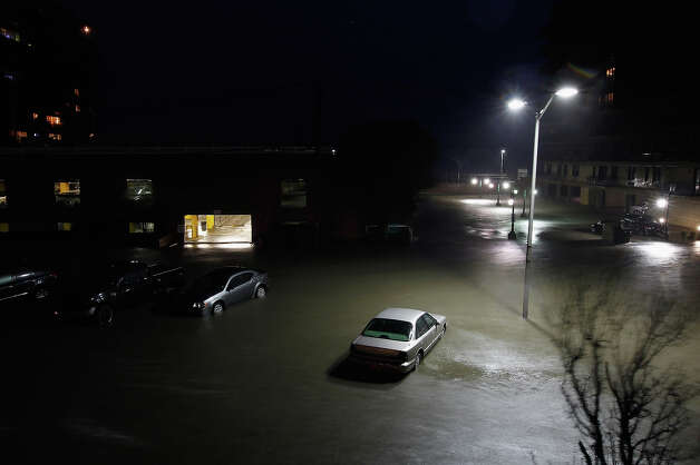 "Flood water runs down West Broadway engulfing parked cars during Hurricane Sandy on October 30, 2012 in Long Beach, New York. The storm has claimed at least 33 lives in the United States, and has caused massive flooding across much of the Atlantic seaboard. U.S. President Barack Obama has declared the situation a ""major disaster"" for large areas of the U.S. east coast, including New York City, with widespread power outages and significant flooding in parts of the city. Photo: Mike Stobe, Getty Images / 2012 Getty Images"