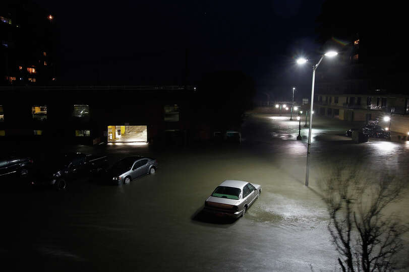 Flood water runs down West Broadway engulfing parked cars during Hurricane Sandy on October 30, 2012