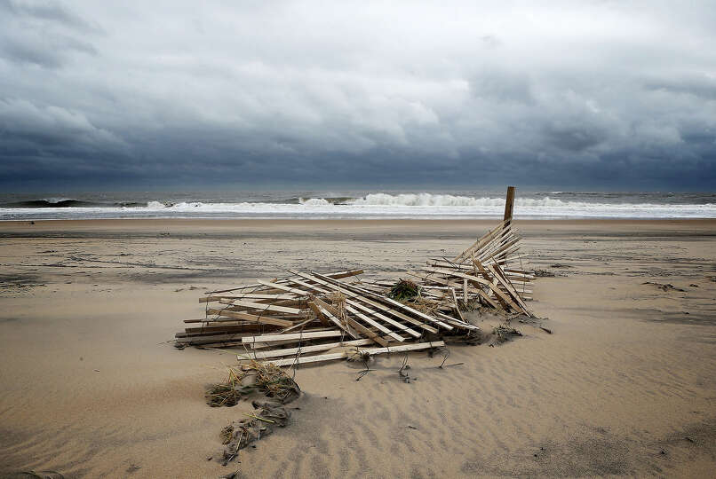 A damaged wooden fence lies at the beach after Hurricane Sandy hit the region October 30, 2012