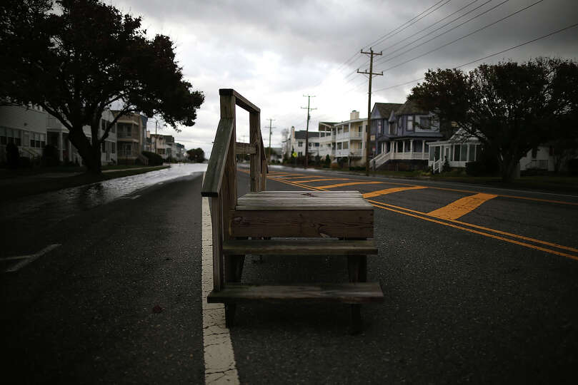 A fragment of wooden stairs sits in the middle of the road after Hurricane Sandy on October 30, 2012