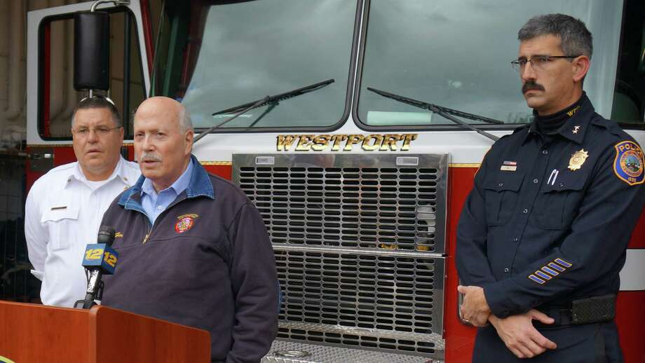 Westport officials -- from left, Deputy Fire Chief Robert Kepchar, First Selectman Gordon Joseloff and Police Chief Dale Call -- talk Tuesday about local recovery efforts from Hurricane Sandy. Photo: Paul Schott