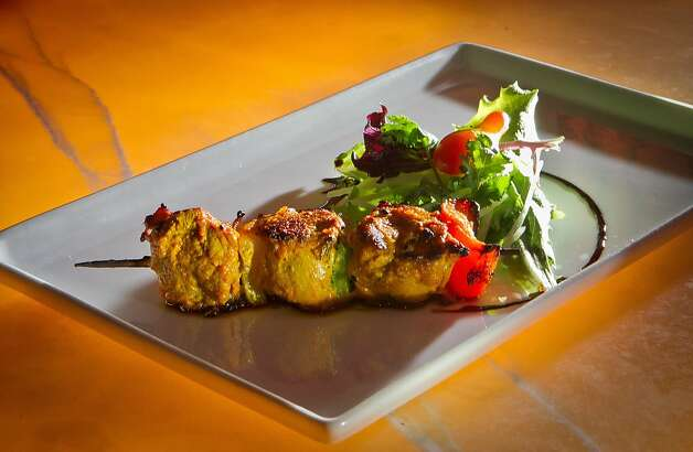 Duck tinka kebab consists of three small skewers of duck breast threaded with peppers and onions and served with a dill and caper sauce. Photo: John Storey