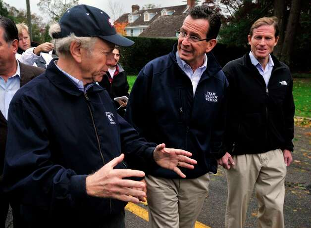 From left, U.S. Sen. Joseph Lieberman, Gov. Dannel P. Malloy and U.S. Sen. Richard Blumenthal tour the damage along Shippan Avenue in Stamford, Conn., caused by the effects of Hurricane Sandy on Tuesday, Oct. 30, 2012. Photo: Jason Rearick / The News-Times