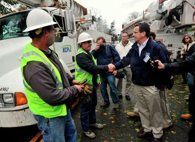 Gov. Dannel P. Malloy greets utility workers from Kansas City while touring the damage along Shippan Avenue in Stamford, Conn., caused by the effects of Hurricane Sandy on Tuesday, Oct. 30, 2012. Photo: Jason Rearick / The News-Times