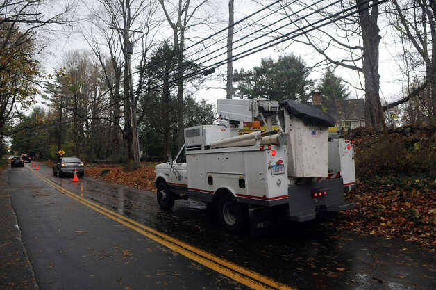 An AT&T crew arrives to assess broken poles on Scofieldtown Road after Hurricane Sandy related weather in Stamford, Conn., Oct. 30, 2012. Photo: Keelin Daly