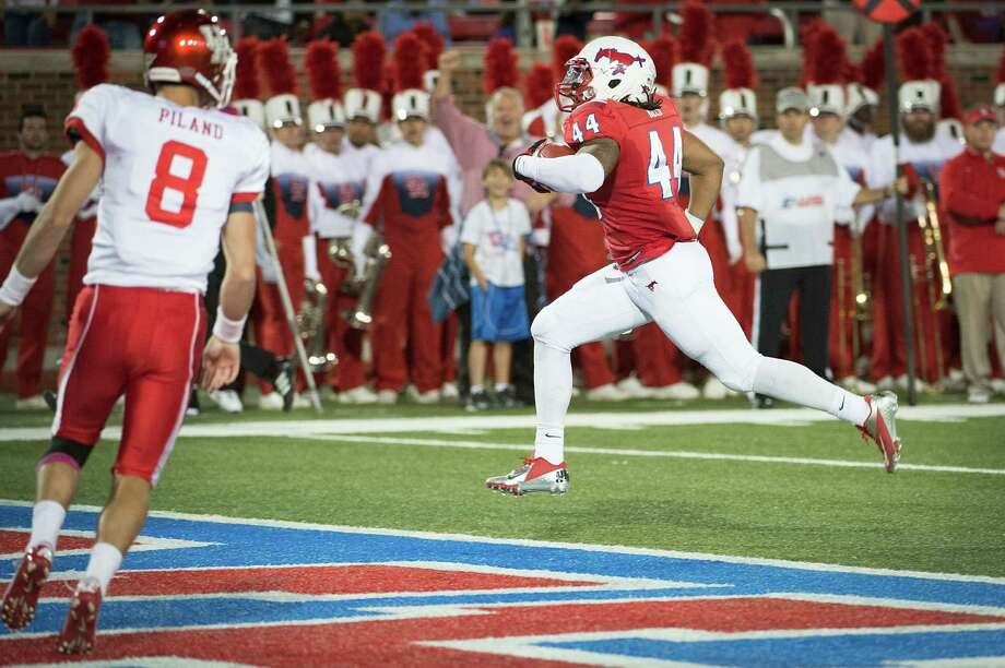 SMU's Taylor Reed returns a David Piland interception for a touchdown, one of nine turnovers UH committed in the Oct. 18 game. Photo: Smiley N. Pool, Staff / © 2012  Houston Chronicle