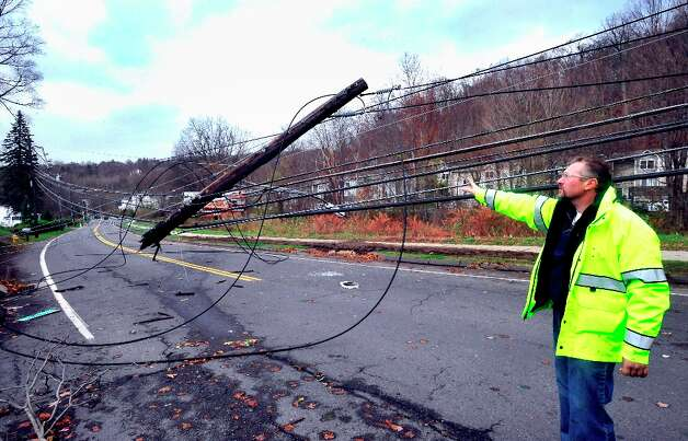 Public Works Director Antonio Iadarola looks at the downed power lines on route 37 and Stacy Road in Danbury, Conn. during Hurricane Sandy Tuesday, Oct. 30, 2012. Photo: Michael Duffy / The News-Times