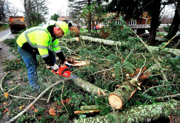Mike Newsome of the Public Works Department works to clear a tree that fell on Barnum Road in Danbury, Conn. during Hurricane Sandy Tuesday, Oct. 30, 2012. Photo: Michael Duffy / The News-Times