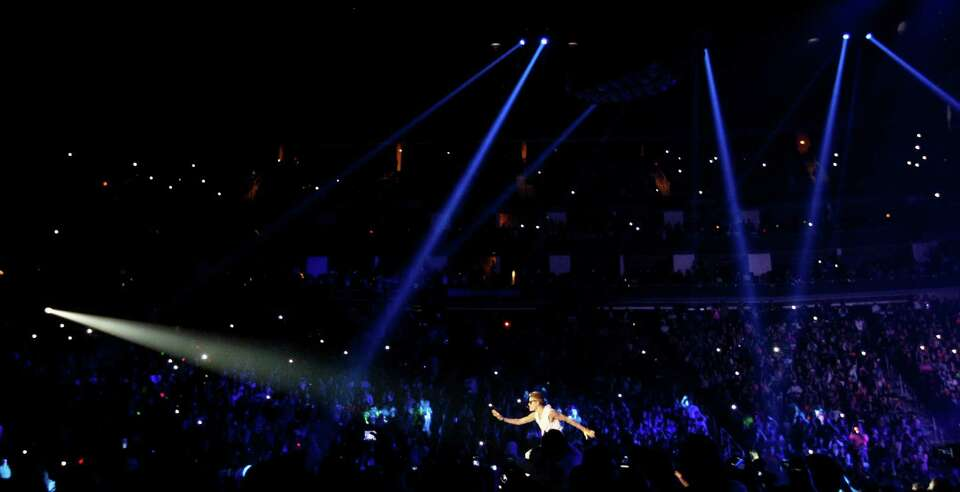 Justin Bieber sings the first three songs of his show for a sold out crowd, Tuesday, Oct. 30, 2012,