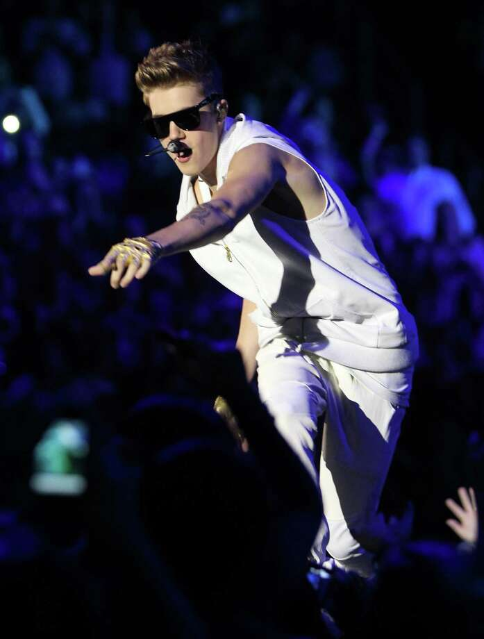 Justin Bieber sings the first three songs of his show for a sold out crowd, Tuesday, Oct. 30, 2012, in the Toyota Center in Houston. Bieber's new album Believe is out now. Photo: Nick De La Torre, Houston Chronicle / © 2012  Houston Chronicle