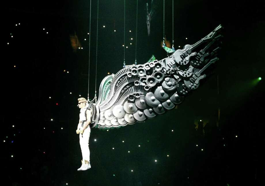 Justin Bieber sings the first three songs of his show, Tuesday, Oct. 30, 2012, in the Toyota Center in Houston. Bieber's new album Believe is out now. Photo: Nick De La Torre, Houston Chronicle / © 2012  Houston Chronicle