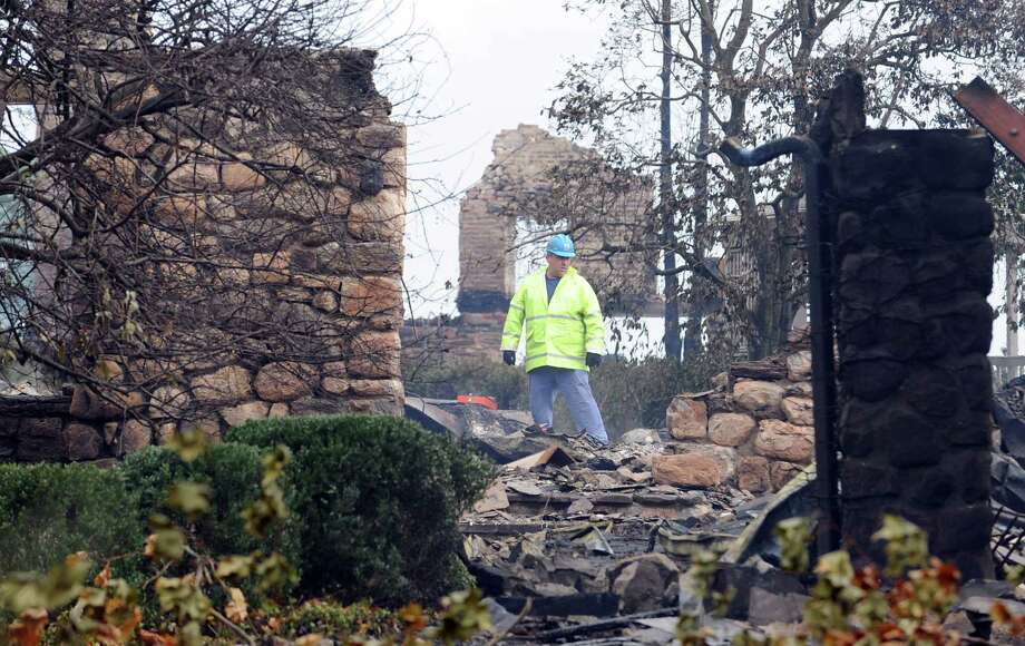 The aftermath of a house fire at 44 Binney Lane in Old Greenwich, Tuesday afternoon, Oct. 30, 2012, the day after Hurricane Sandy hit in Old Greenwich. Photo: Bob Luckey / Greenwich Time
