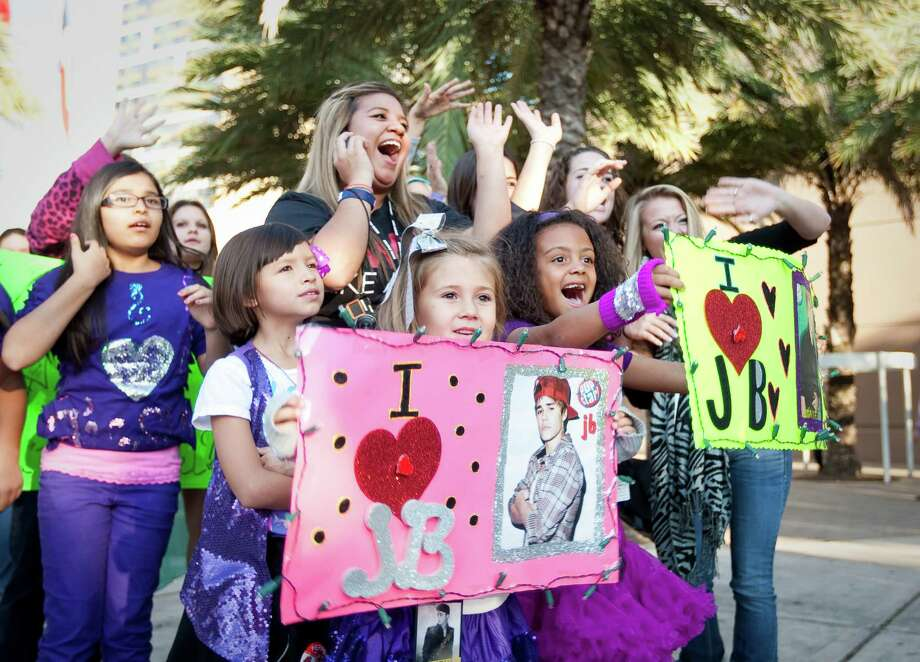 Adalee Campbell, 6, of Houston, and a random group of girls show they have the Bieber fever to a TV station, Tuesday, Oct. 30, 2012, in the Toyota Center in Houston. Bieber's new album Believe is out now. Photo: Nick De La Torre, Houston Chronicle / © 2012  Houston Chronicle