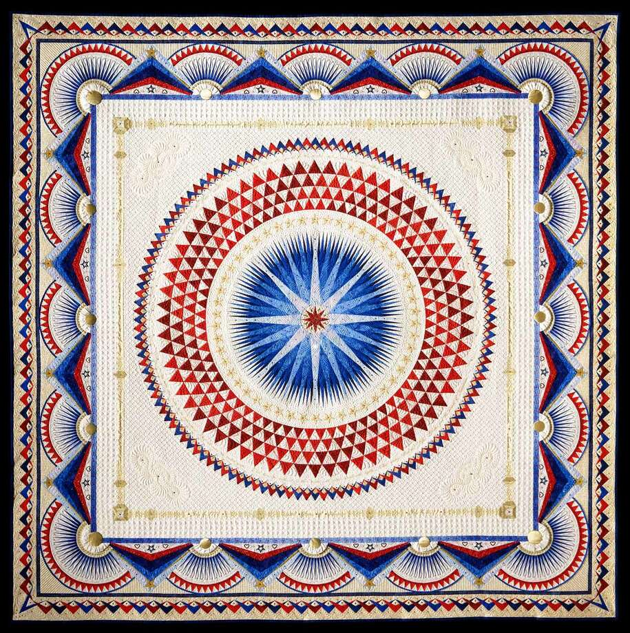 """America, Let It Shine"" by Sherry Reynolds of Laramie, Wyo. is the winner of the Handi Quilter Best of Show Award, the $10,000 grand prize, at International Quilt Festival Houston. To see more of the quilts, go to Chron.com or the iPad edition. Photo: --"