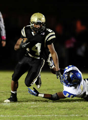 Nederland running back Kendrick Hopkins, 24, charges for a first down during the Nederland High School football game against Ozen High School at Nederland High School on Friday, October 26, 2012. Photo taken: Randy Edwards/The Enterprise Photo: Randy Edwards