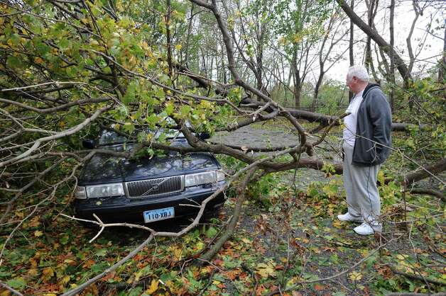 Tom Williams of Byram views his damaged car on Mead Avenue during the aftermath of Hurricane Sandy in Byram, Tuesday morning, Oct. 30, 2012. Photo: Bob Luckey / Greenwich Time