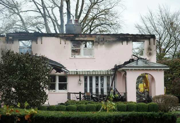 The aftermath of a house fire at 36 Binney Lane in Old Greenwich, Tuesday afternoon, Oct. 30, 2012, the day after Hurricane Sandy hit in Old Greenwich. Photo: Bob Luckey / Greenwich Time