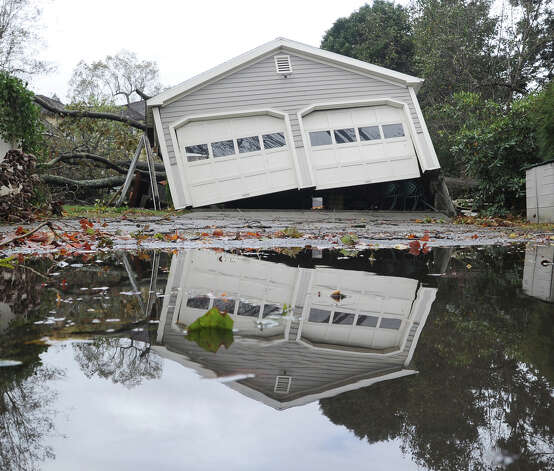 A garage off its foundation on Binney Lane during the aftermath of Hurricane Sandy in Old Greenwich, Tuesday, Oct. 30, 2012. Photo: Bob Luckey / Greenwich Time