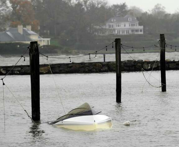 A sunk boat at the Byram Docks during the aftermath of Hurricane Sandy in Byram, Tuesday morning, Oct. 30, 2012. Photo: Bob Luckey / Greenwich Time