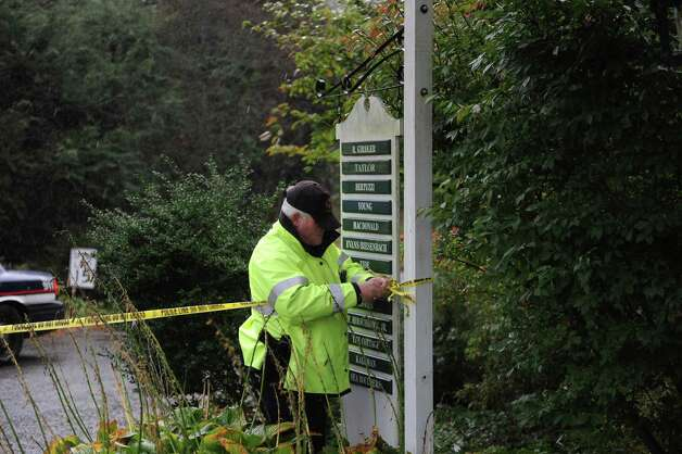 A Greenwich police officer ropes off Binney Lane in Greenwich, Conn. on Tuesday, Oct. 30, 2012.  Fire damaged several home during storms related to Hurricane Sandy. Photo: Helen Neafsey / Old Greenwich