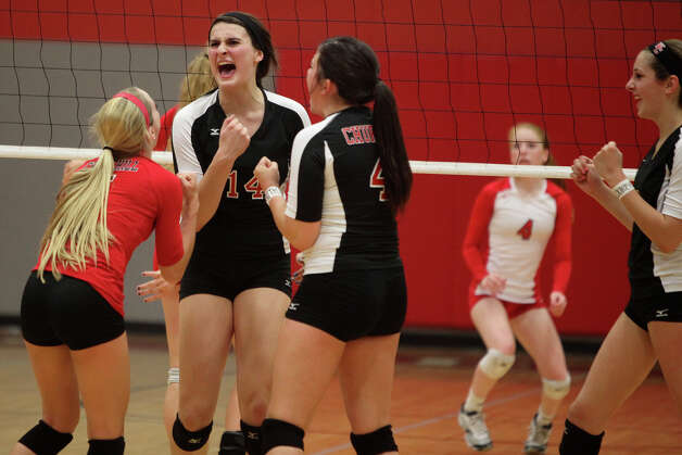 Churchill's Amy Nettles, from left, Abby Buckingham, Katie Pope and Karley York celebrate a point against New Braunfels Canyon during their Class 5A first round playoff match at Judson High School on Tuesday, Oct. 30, 2012. Photo: Lisa Krantz, San Antonio Express-News / San Antonio Express-News