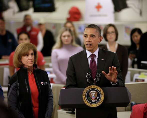 President Barack Obama, accompanied by American Red Cross President and CEO Gail J. McGovern, gestures while speaking during the his visit to the Disaster Operation Center of the Red Cross National Headquarter to discuss superstorm Sandy, Tuesday, Oct. 30, 2012, in Washington. (AP Photo/Pablo Martinez Monsivais) Photo: Pablo Martinez Monsivais