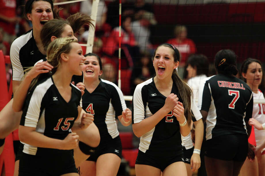 The Churchill volleyball team, including Abby Buckingham, from left, Taylor Martinez, Shelby Arnold, Katie Pope and Karley York celebrates their win against New Braunfels Canyon at the conclusion of their Class 5A first round playoff match at Judson High School on Tuesday, Oct. 30, 2012. Photo: Lisa Krantz, San Antonio Express-News / San Antonio Express-News
