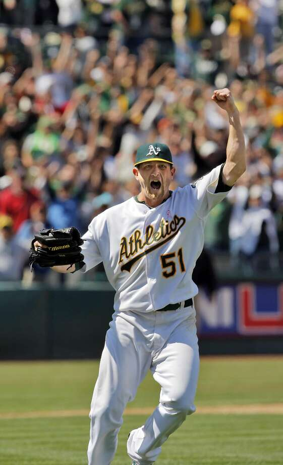 Dallas Braden reacts to the last out in a game against the Tampa Bay Rays in which he pitched a perfect game, the 19th in MLB history. The Oakland Athletics played the Tampa Bay Rays at the Oakland Alameda County Coliseum in Oakland, Calif., on Sunday, M Photo: Carlos Avila Gonzalez, The Chronicle