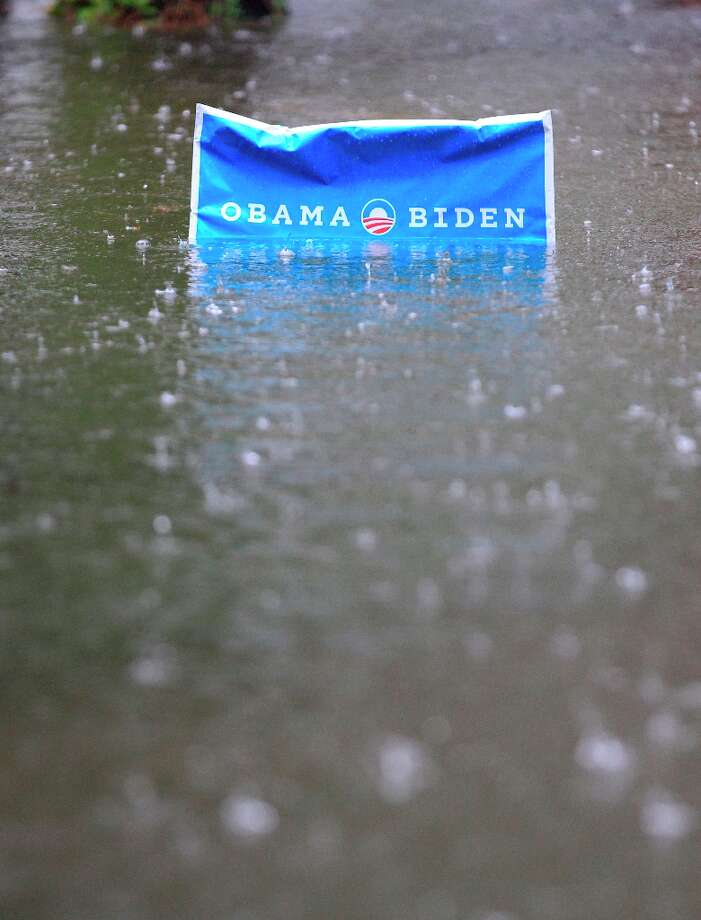 An Obama campaign sign rises above the floodwaters in a neighborhood as rain continues to fall in  Norfolk, VA., Monday, Oct. 29, 2012.  Rain and wind from Hurricane Sandy are hitting the area. Photo: Steve Helber, Associated Press / AP