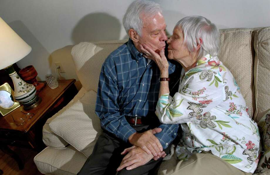 Dolly and Len Dooren, both 92, pucker up for a kiss in their apartment on Thursday, July 23, 2009, at Hawthorne Ridge Nursing Home in East Greenbush, N.Y. The couple, married nearly 70 years, were reunited with a  long-lost love letter from E-Bay buyer Lorraine Alweiss of Staten Island. (Cindy Schultz / Times Union) Photo: CINDY SCHULTZ / 00004836A