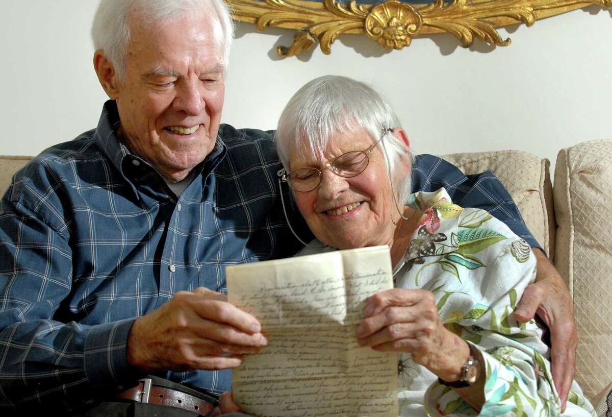 Dolly and Len Dooren, both 92, read a long-lost love letter in their apartment on Thursday, July 23, 2009, at Hawthorne Ridge Nursing Home in East Greenbush, N.Y. The couple, married nearly 70 years, were reunited with the letter from E-Bay buyer Lorraine Alweiss of Staten Island. (Cindy Schultz / Times Union)
