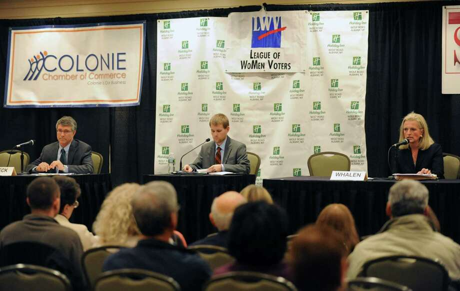 Charles Wiff, managing editor of the Spotlight Newspapers, center, moderates a debate between candidates for the 110th Assembly District Phillip G. Steck, left, and Jennifer A. Whalen in Colonie, NY Tuesday Oct. 30, 2012. (Michael P. Farrell/Times Union) Photo: Michael P. Farrell