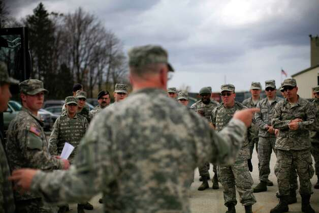 Members of the 109th Airlift Wing of the New York Air National Guard, prepare to deploy to assist with coastal recovery from Hurricane Sandy at the National Guard base in Latham, N.Y., Oct. 30, 2012. Sandy moved inland Tuesday after grinding life to a halt for millions of people in more than a half-dozen states, leaving behind the daunting task of cleaning up. (Nathaniel Brooks/The New York Times) Photo: NATHANIEL BROOKS / NYTNS
