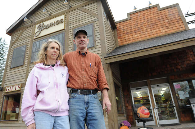 Peggy and Jim Young stand in front Young's general store which they own on Tuesday, Oct. 30, 2012 in Prattsville, N.Y. (Lori Van Buren / Times Union) Photo: Lori Van Buren