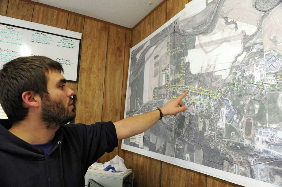Josh DeBartolo, Volunteer Coordinator for Schoharie Recovery, points to a map in the volunteer headquarters trailer with pushpins indicating the progress of damaged homes being repaired on Tuesday, Oct. 30, 2012 in Schoharie, N.Y.  (Lori Van Buren / Times Union) Photo: Lori Van Buren
