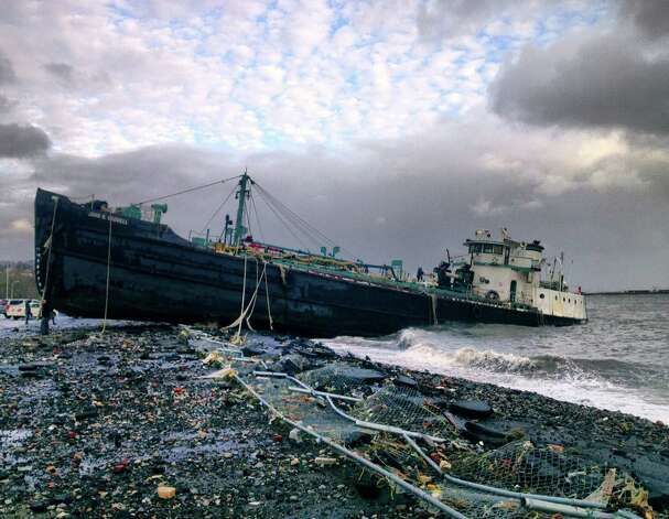 A 168-foot water tanker, the John B. Caddell, sits on the shore Tuesday morning, Oct. 30, 2012 where it ran aground on Front Street in the Stapleton neighborhood of New York's Staten Island as a result of superstorm Sandy. (AP Photo/Sean Sweeney) Photo: Sean Sweeney