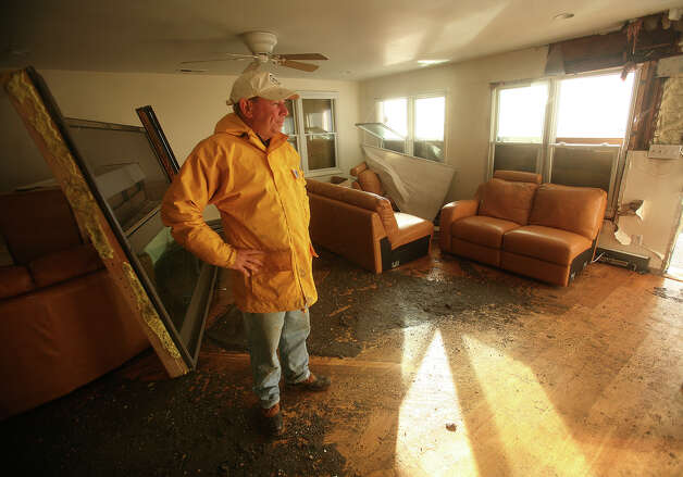 Jim Secondi surveys the damage from Hurricane Sandy to his waterfront home at 101 Melba Street in the Bayview section of Milford on Tuesday, October 30, 2012. Photo: Brian A. Pounds
