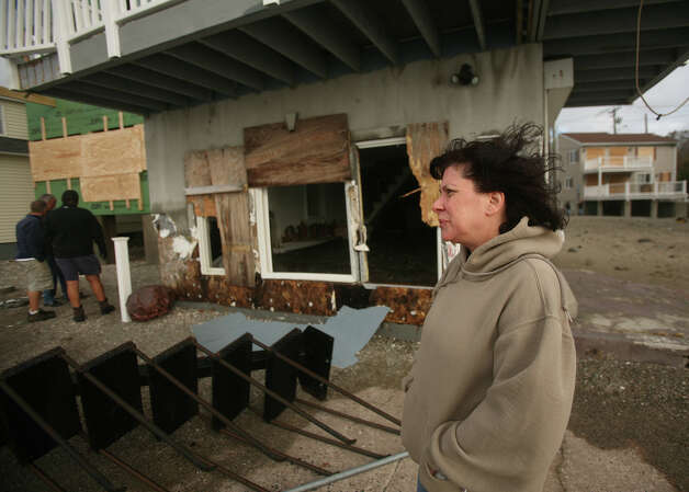 Lauren Geib of West Haven surveys the damage to homes from Hurricane Sandy in the Bayview section of Milford on Tuesday, October 30, 2012. Photo: Brian A. Pounds