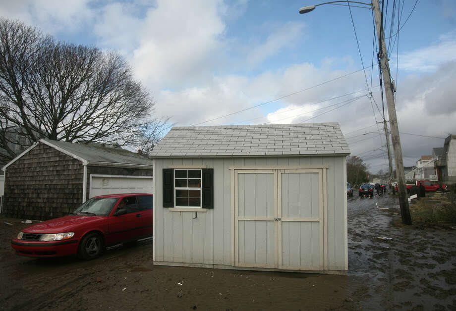 A shed, displaced by Hurricane Sandy, rests in the middle of Melba Street in the Bayview section of Milford on Tuesday, October 30, 2012. Photo: Brian A. Pounds