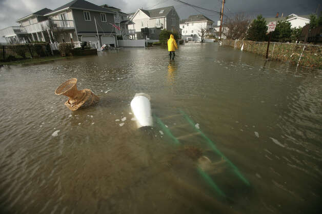 Flood waters from Hurricane Sandy on Point Beach Drive in Milford on Tuesday, October 30, 2012. Photo: Brian A. Pounds